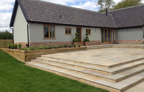 Hard landscaping and oak staircase
